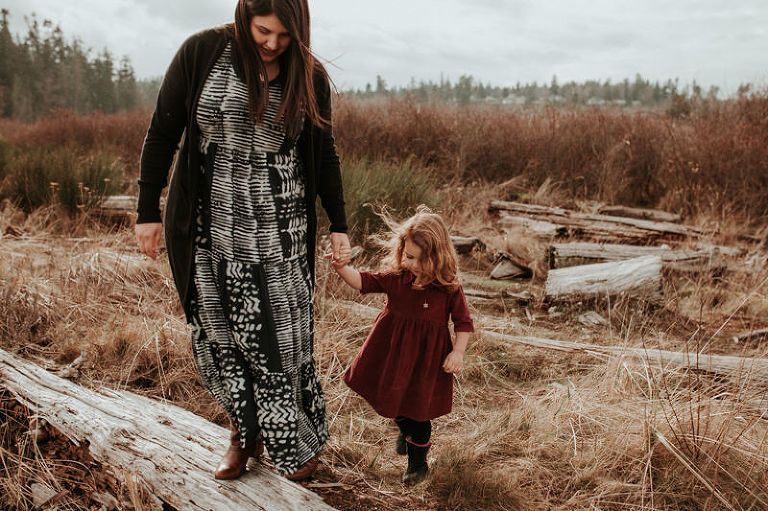 Lifestyle portrait session in Kitsap County, with mom wearing a maxi dress, holding daughter's hand.