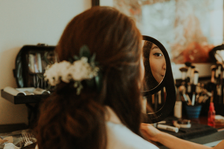 Bride getting ready in Bellevue, with fresh flowers in her hair.